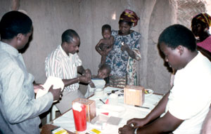 <figcaption>A malaria research clinic in a Malian village.</figcaption>