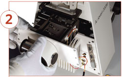 <figcaption>Plug in the TILL TIRF condenser and fasten the screws again. Credit: IMAGE COURTESY OF MATTHIAS ASCHERL, TILL PHOTONICS</figcaption>