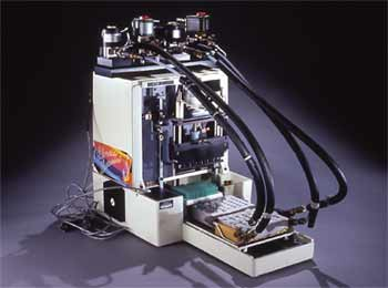<figcaption>A 1985 prototype of a semi-automated thermal cycler, hot and cold water baths not included. Credit: Courtesy of The Smithsonian Institution</figcaption>