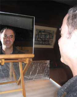 <figcaption>For an hour each morning Seth Roberts gazes at his own visage in the mirror. His experiments have convinced him that the practice elevates his mood. Credit: Courtesy of Gordy Slack</figcaption>